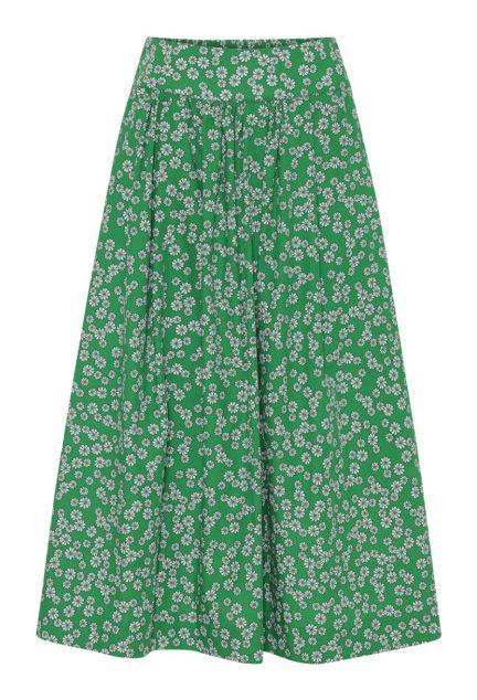 Nederdelen – den lange i grøn med blomster