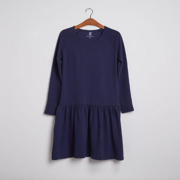 Kjolen - den med de lange ærmer er økologisk og certificeret med GOTS